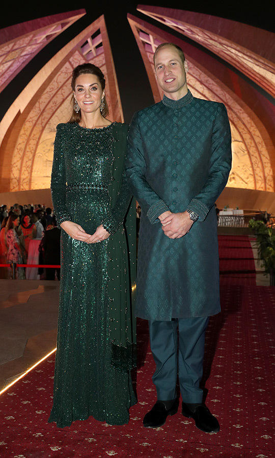 "We weren't done with amazing looks that day! At a reception in their honour hosted by the British High Commissioner at the Pakistan National Monument in Islamabad, Kate dazzled in a sparkling green emerald gown by <strong><a href=""/tags/0/jenny-packham"">Jenny Packham</a></strong>. Kate accessorized with a matching scarf and earrings by British-Pakistani designer <strong>Onitaa</strong>. 