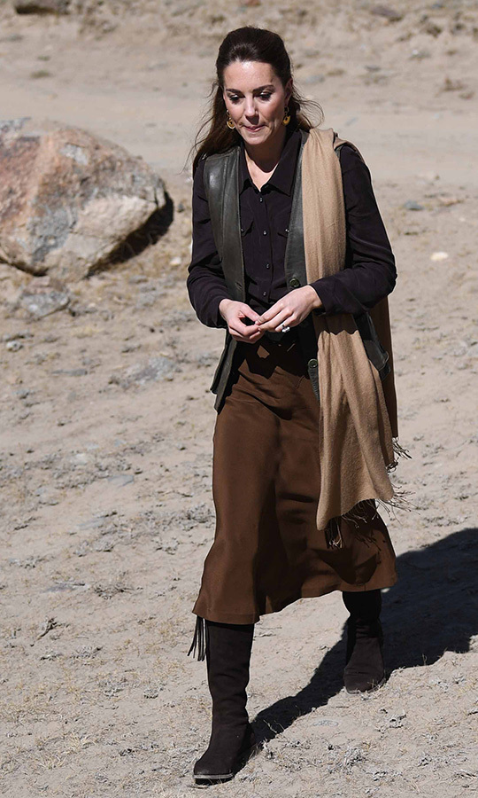 The next day, for a trip to a glacier and a Kalash village, Kate chose a brown midi skirt, brown leather waistcoat, brown dress shirt, suede <strong>Really Wild</strong> boots and drop earrings by <strong>Missoma</strong>. 