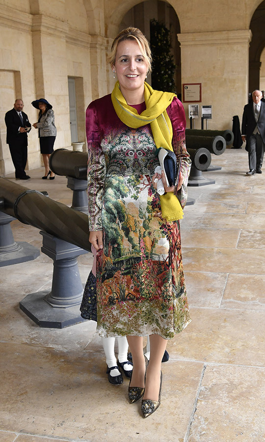 <strong>Princess Philomena d'Orleans</strong>, the Countess of Paris, arrived in a colourful patterned dress and mustard scarf. 
