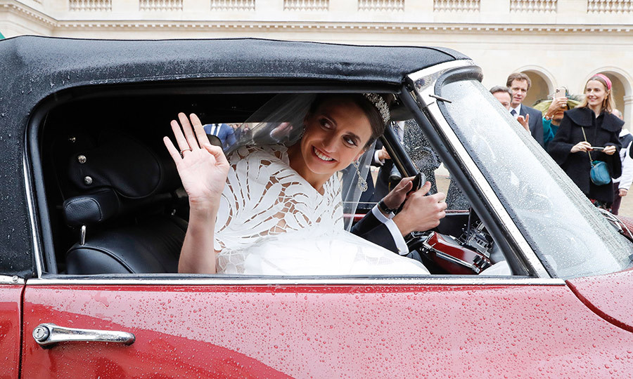 They happily waved as they drove off.
