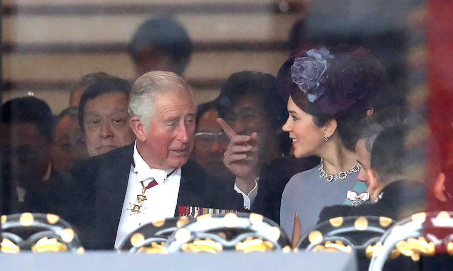 Charles and Mary took some time to chat once seated. 