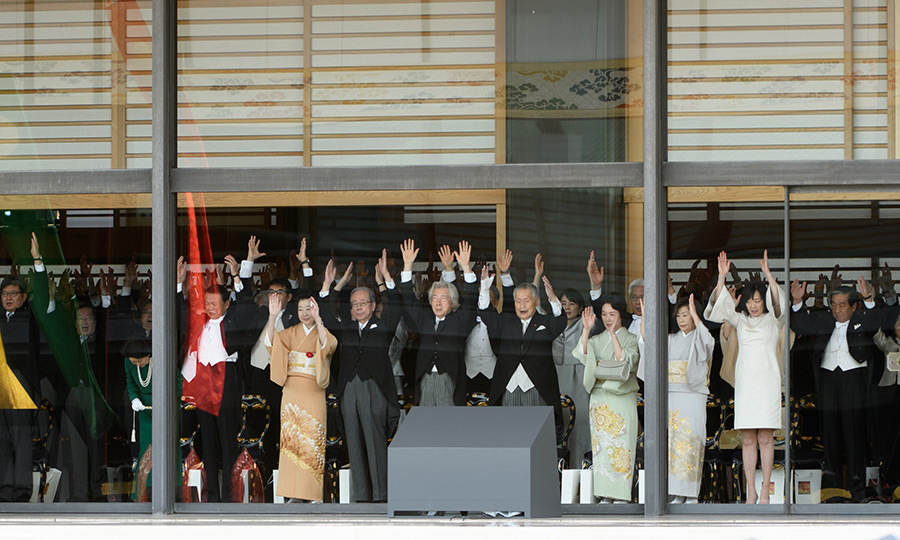 "All the attendees raised their hands to give a ""banzai!"" cheer during the ceremony.