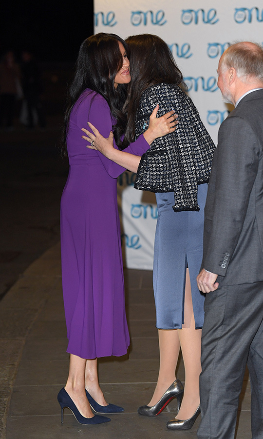 Meghan greeted the organizers with hugs.