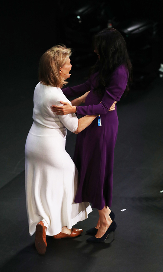 She gave yet another hug, this time to the MC. 