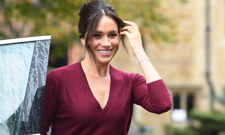 The couple arrived by car, which was being driven by Harry. Meghan looked gorgeous, wearing a burgundy blouse with a red leather skirt, and wore her hair up in a beehive – that's not a hairstyle we've seen her wear much before!