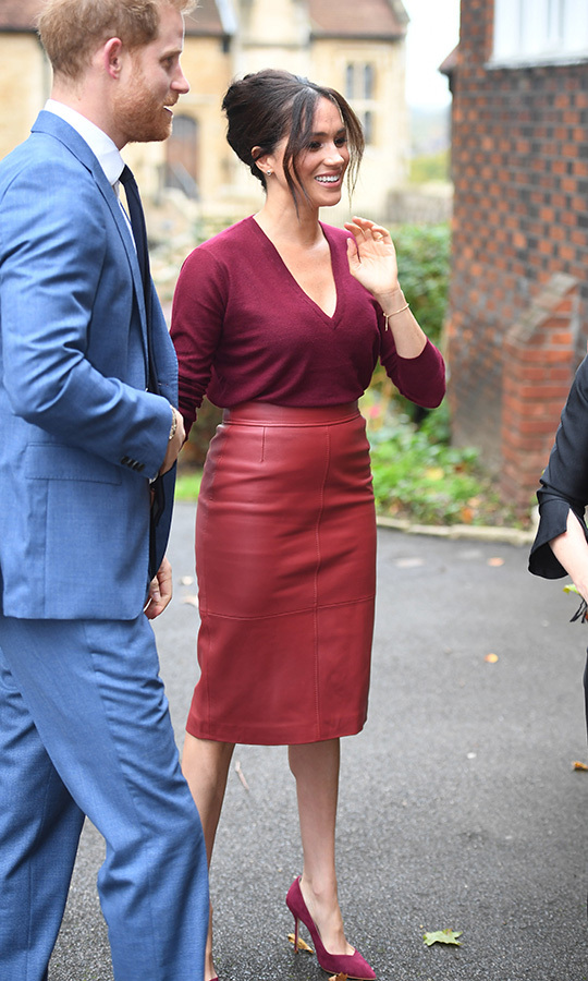 "Meghan's red leather pencil skirt is by <strong><a href=""/tags/0/hugo-boss"">Hugo Boss</a></strong>. We also saw Spain's <strong><a href=""/tags/0/queen-letizia"">Queen Letizia</a></strong>   <strong><a href=""https://ca.hellomagazine.com/fashion/royal-style/gallery/2019102579685/meghan-markle-queen-letizia-twinning-matching-style/1/"">wearing the exact same skirt</a></strong> just this week!