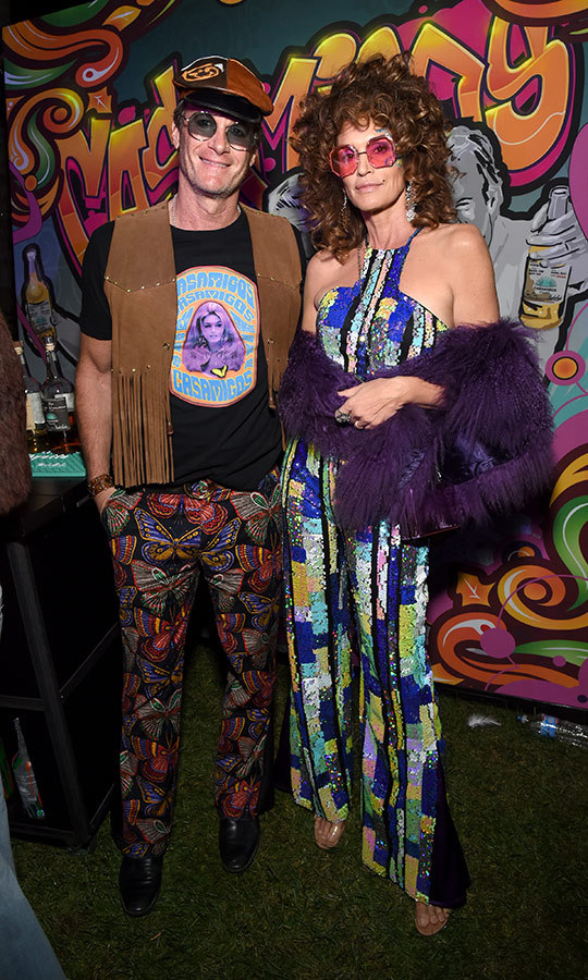 "Trippy costumes, man! <strong>Rande Gerber</strong> and <strong><a href=""/tags/0/cindy-crawford"">Cindy Crawford</a></strong> certainly looked the part at the Casamigos Halloween Party in Beverly Hills. 