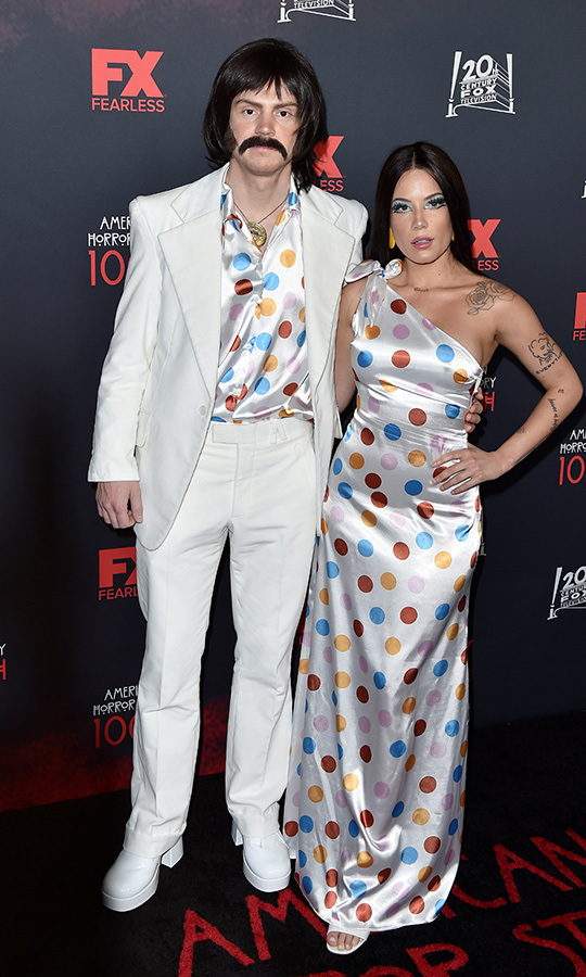 "<strong><a href=""/tags/0/halsey"">Halsey</a></strong> and <strong>Evan Peters</strong> made their romance official by going as Sonny and Cher to the <i>American Horror Story</i> 100th episode party in Los Angeles.