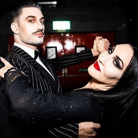 "<strong><i><a href=""/tags/0/rupauls-drag-race"">RuPaul's Drag Race</a></i></strong> star <strong>Michelle Visage</strong> and <strong>Giovanni Pernice</strong>, her partner on hit UK show <i>Strictly Come Dancing</i>, dressed up as Gomez and Morticia Addams to perform the foxtrot on the show!