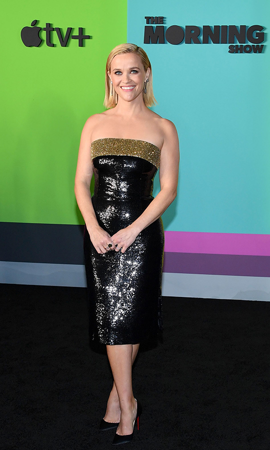Reese shimmered in a sequinned bandeau dress by <strong>Celine</strong> which looked as classic '90s as it did immediately chic. 