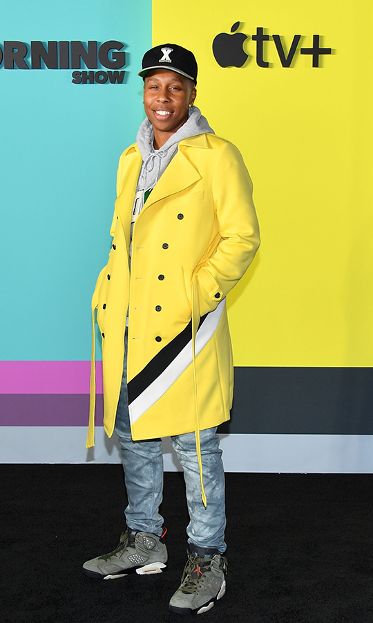 Writer <strong>Lena Waithe</strong> kept it casual, opting for jeans, a hoodie, a baseball cap, high-top shoes and a yellow, white and black jacket. 