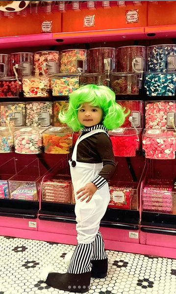 Khloe later posted this sweet photo of True in the candy aisle at a store, dressed like an Oompa Loompa from <i>Charlie and the Chocolate Factory</i>!