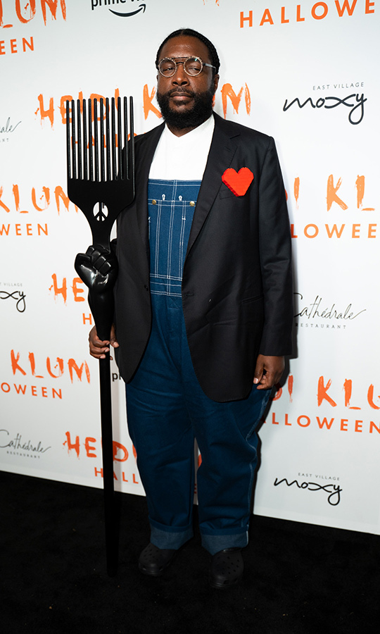 "<strong><a href=""/tags/0/the-roots"">The Roots</a></strong>' <strong><a href=""/tags/0/questlove"">Questlove</a></strong> went as a modern spin on Grant Wood's beloved painting ""American Gothic."" 