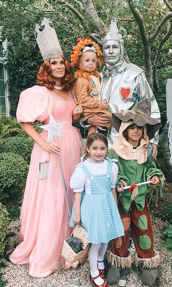 "<strong><a href=""/tags/0/molly-sims"">Molly Sims</a></strong> was Glenda the Good Witch from <i>The Wizard of Oz</i>, while her entire family were the Tin Man, Cowardly Lion, Scarecrow and Dorothy. SO sweet!