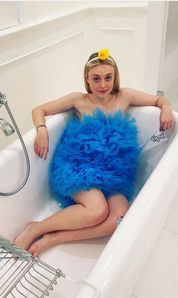 "<strong><a href=/tags/0/dakota-fanning>Dakota Fanning</a></strong> decided to dress up as the ""scrub-a-dub-dub,"" complete with a rubber duckie.