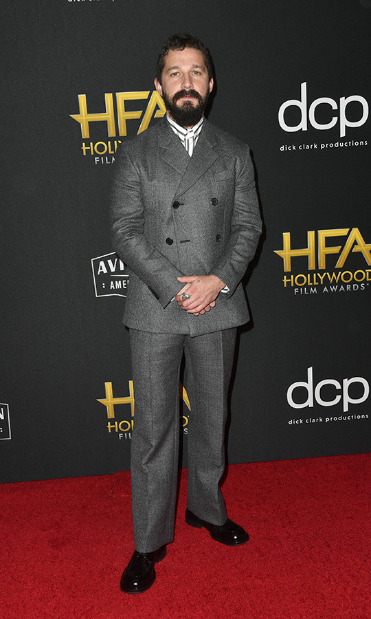 "<strong><a href=""/tags/0/shia-labeouf"">Shia Labeouf</a></strong> chose a simple grey suit and black-and-white shirt for his red carpet look. The star accepted the Breakthrough Screenwriter Award for the screenplay for <i>Honey Boy</i>.