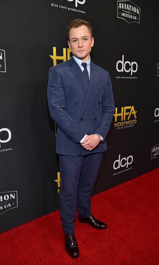 "<strong><A href=""/tags/0/taron-egerton"">Taron Egerton</a></strong> looked dapper in a blue suit as he picked up the Breakout Actor Award for his performance as <strong><a href=""/tags/0/elton-john"">Elton John</a></strong> in <i>Rocketman</i>.