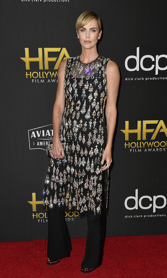 "<p><strong><a href=""/tags/0/charlize-theron"">Charlize Theron</a></strong> looked amazing in a sequinned sheer black dress, which she paired with black trousers and heeled sandals. She accepted the Career Achievement Award. 