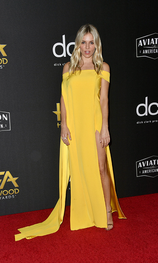 "<strong><a href=""/tags/0/sienna-miller"">Sienna Miller</a></strong> really stood out on the red carpet in this off-the-shoulder mustard <strong>CONG TRI</strong> gown. 