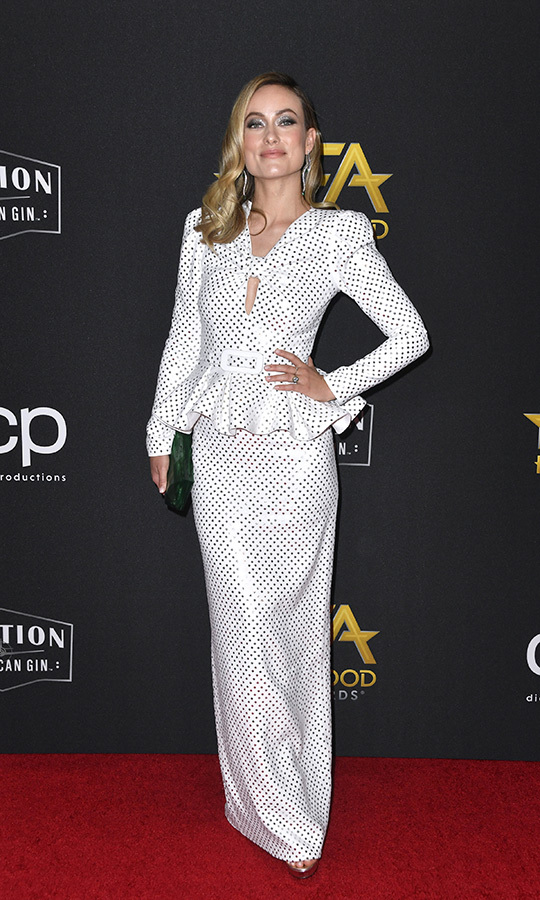 "<strong><a href=""/tags/0/olivia-wilde"">Olivia Wilde</a></strong> looked stunning in a black-and-white <strong><a href=""/tags/0/michael-kors"">Michael Kors</a></strong> ensemble. She accepted the Breakthrough Director Award for <i>Booksmart</i>.
