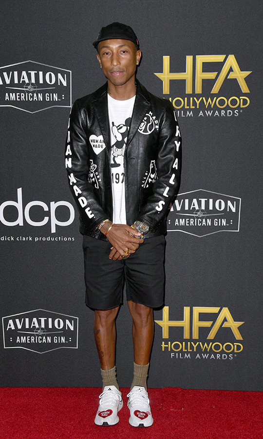 "Yup, <strong><a href=""/tags/0/pharrell-williams"">Pharrell Williams</a></strong> was wearing shorts in November, but remember... Hollywood is warm! The star chose a Mickey Mouse T-shirt, black hat, leather jacket and runners to complete his look. He accepted the award for Hollywood Song for ""Letter to My Godfather"" from <i>The Black Godfather</i>.
