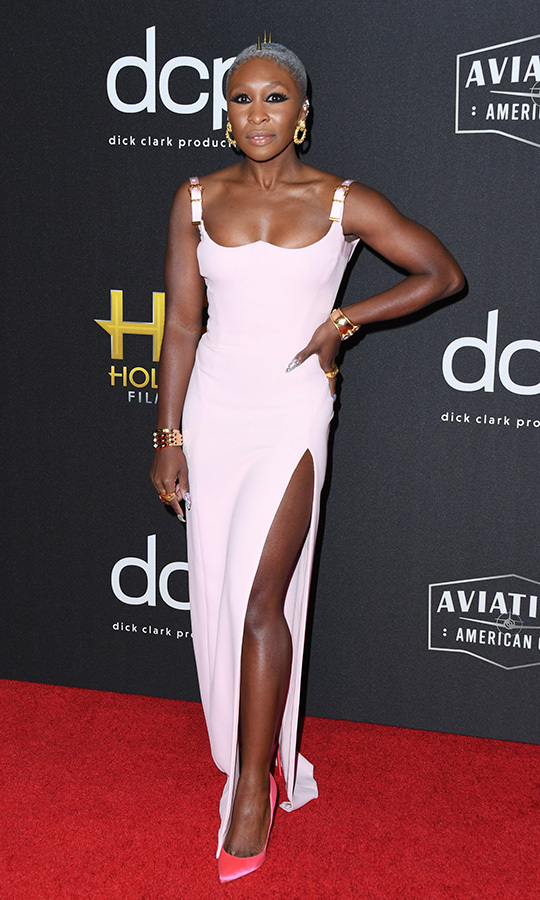 "<strong><a href=""/tags/0/cynthia-erivo"">Cynthia Erivo</a></strong> has already made a name for herself on Broadway, and broke out into the world of film this year with her starring role in <i>Harriet</i>. She accepted the Breakout Actress Award for her role in the film and looked stunning in a blush dress with a thigh-high slit that showed off bright pink heels. 