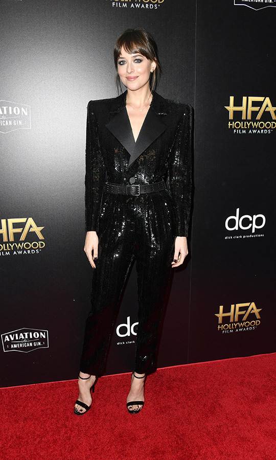 "<strong><a href=""/tags/0/dakota-johnson"">Dakota Johnson</strong></a> looked classy and stunning in a sequinned black pantsuit with strappy heels. 
