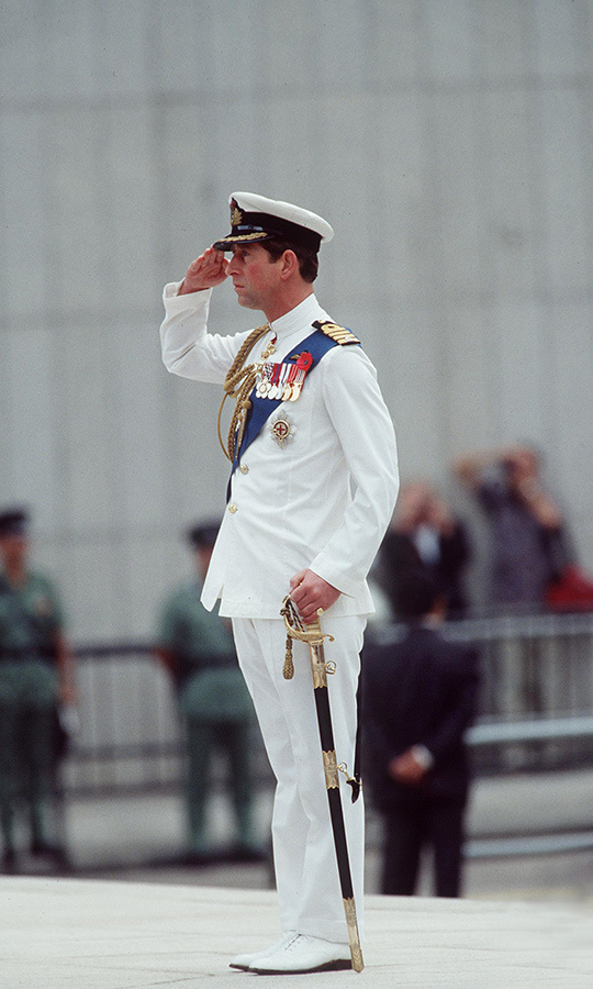 Charles attending a Remembrance Day ceremony in Hong Kong in 1992 wearing his tropical white naval uniform.