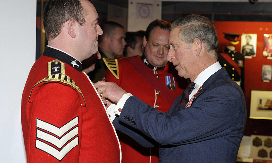 Prince Charles as Colonel in Chief of the Welsh Guards presents a long service medal to <strong>Lance Sergeant Lane</strong> (left) following Remembrance Sunday service at Wellington Barracks (the home of the Welsh guards in London) on Nov. 9, 2008. 
