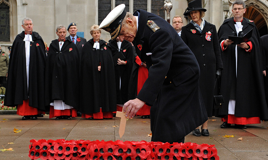 Prince Philip places a Cross of Remembrance at the Field of Remembrance during the opening ceremony in 2010.