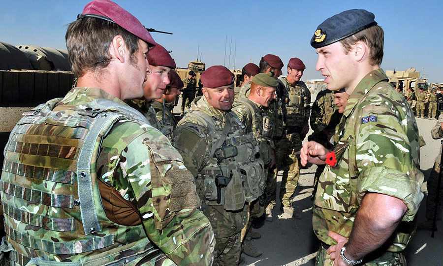 Prince William speaks to members of the British Parachute Regiment at Camp Bastion in Afghanistan  before a Remembrance Day ceremony on Nov. 14, 2010.