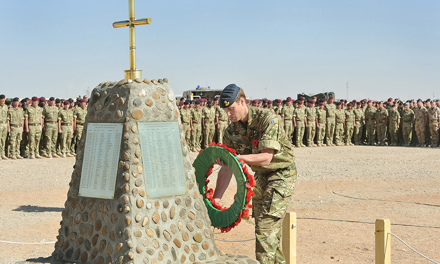 Prince William places a wreath on the memorial to the British soldiers killed in Afghanistan during the Remembrance Day ceremony at Camp Bastion in 2010.