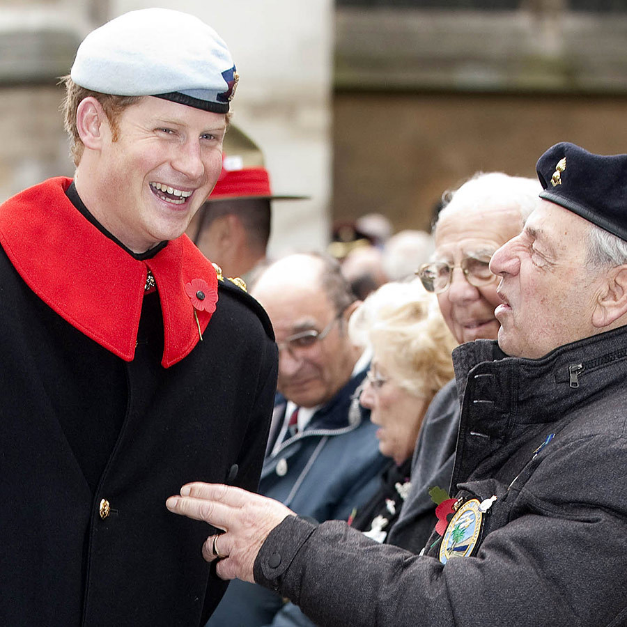 Prince Harry shares a moment with veterans at the Field of Remembrance at Westminster Abbey in 2013.