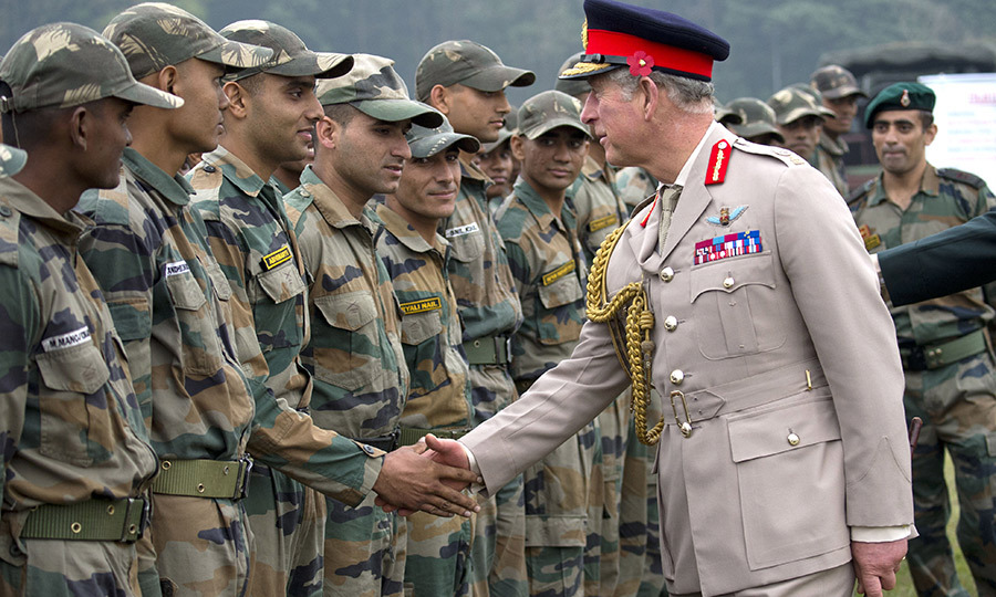 Prince Charles meets troops during a visit to the Indian Military Academy in Dehradun in 2013 as part of his and Camilla's royal tour of India.