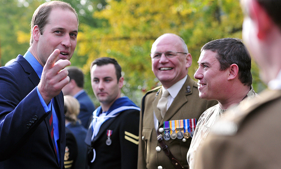 Prince William chats with military personnel, staff and volunteers from the Royal British Legions London Poppy Day Appeal at Kensington Palace on Nov. 7, 2013. 