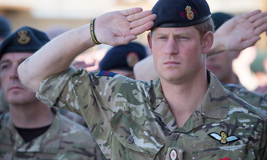 Prince Harry joins British troops and service personnel along with International Security Assistance Force (ISAF) personnel and civilians for Remembrance Sunday service at Kandahar Airfield in Afghanistan on November 9, 2014.