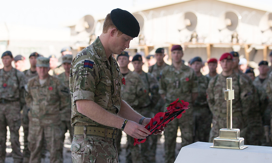 Harry lays a poppy wreath during the Remembrance Sunday service.