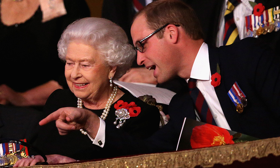 The Queen and grandson Prince William have a moment at the Royal Box at the Royal Albert Hall during the Annual Festival of Remembrance on Nov. 7, 2015.