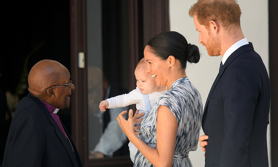 "Royal fans got a very sweet treat back in September, when Meghan and Harry brought their son to meet Archbishop <strong><a href=""/tags/0/desmond-tutu"">Desmond Tutu</a></strong> while they were on their <a href=""/tags/0/2019-african-royal-tour""><strong>tour of southern Africa</a></strong>. Archie was immediately friendly to Desmond, reaching out towards the legendary human rights activist and anti-apartheid leader, who smiled right back. 