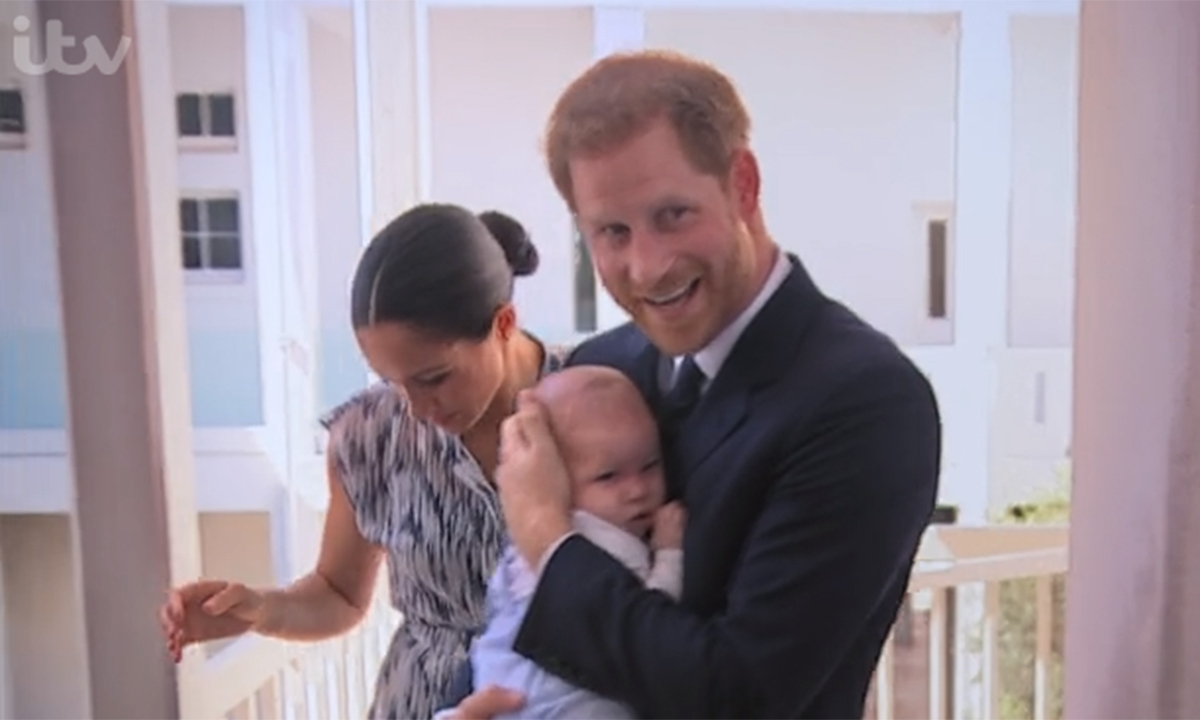 In a sweet video before their visit, Harry could be seen proudly bumping Archie up and down in his arms, smiling happily for the camera. 