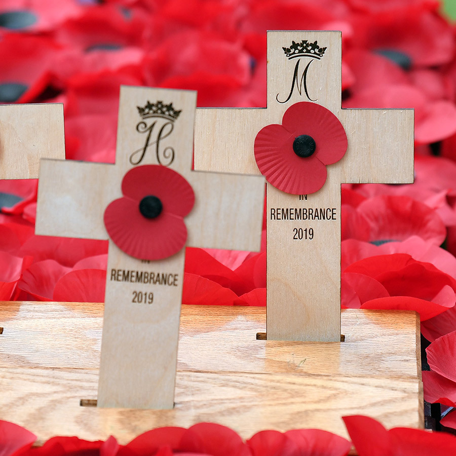 Here's a closer look at their crosses, which are decorated with their coats of arms. 