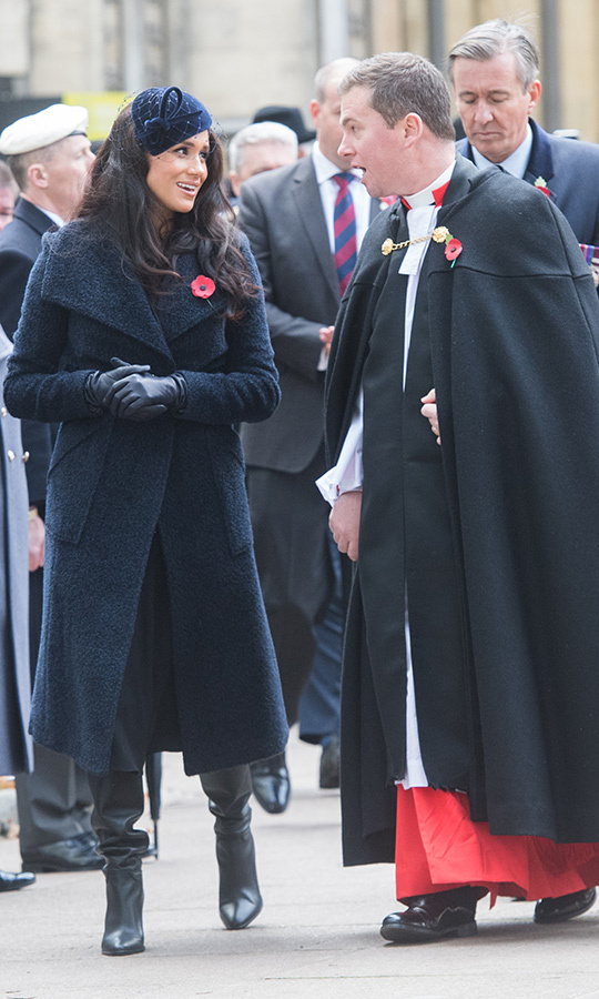 "Meghan looked gorgeous at the engagement, wearing a blue <strong><a href=""/tags/0/sentaler"">Sentaler</a></strong> teddy coat, black boots from <strong><a href=""/tags/0/tamara-mellon"">Tamara Mellon</a></strong> and a navy fascinator from <Strong><a href=""/tags/0/philip-treacy"">Philip Treacy</a></strong>.