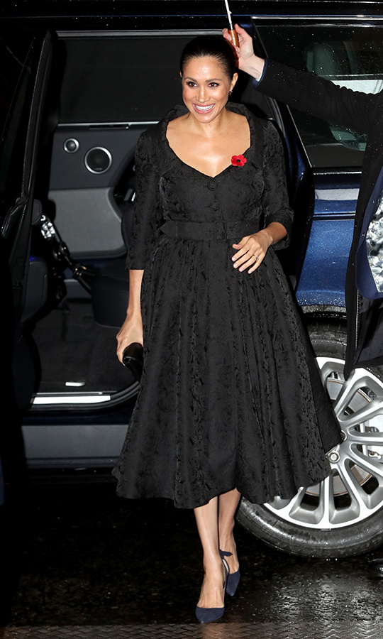 "<strong><a href=""/tags/0/meghan-markle"">Duchess Meghan </a></strong>arrived at Royal Albert Hall looking relaxed and pleased to be there. She chose an entirely black outfit, as is customary for Remembrance Day, wearing a black brocade dress with a v-neckline. Those are black <strong><a href=""/tags/0/aquazzura"">Aquazzura</a></strong> pumps on her feet. She came wearing the customary Remembrance Day poppy. 