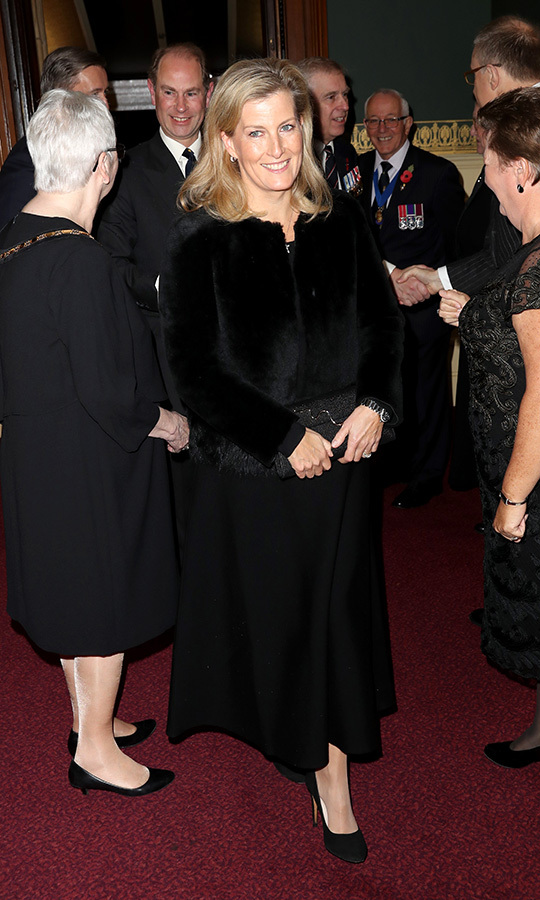 "<strong><a href=""/tags/0/countess-of-wessex"">Sophie, Countess of Wessex</a></strong> chose a black faux fur jacket and black skirt, which she accessorized with a black clutch. 