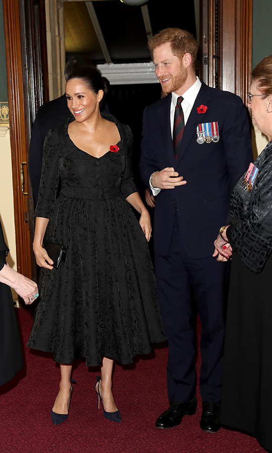 Harry and Meghan showed off their best smiles as they were greeted by organizers upon arrival. 