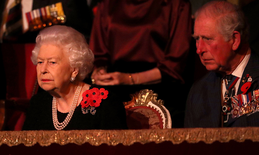 After everyone took their seats, The Queen and Charles looked on seriously at the events below on stage. 