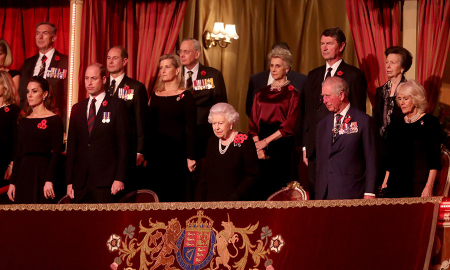 Everyone stood as the Queen took her seat. 