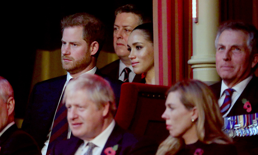 "Harry and Meghan stood at the back of the balcony at one point, just behind UK Prime Minister <strong>Boris Johnson</strong> and his partner, <strong>Carrie Symonds</strong>. The event is particularly emotional for Harry, who is a veteran of the Afghanistan War and founded the <strong><a href=""/tags/0/invictus-games"">Invictus Games</a></strong> to help veterans and ex-servicemembers. 