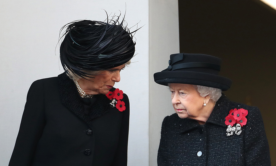 Camilla, who was on the same balcony as the Queen for the event, had a short conversation with Her Majesty before the commemoration got underway. 