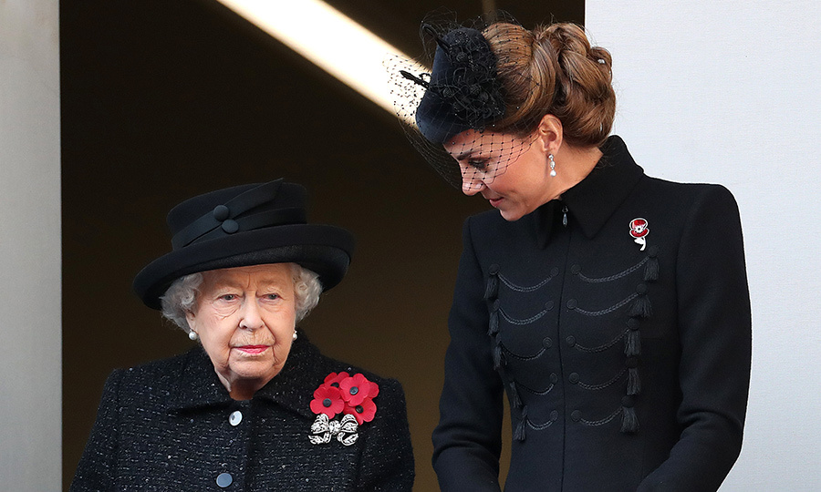 Kate stood on the same balcony and also spoke to the Queen as the event started. 